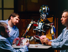SARCOS android robot plays cards with engineers