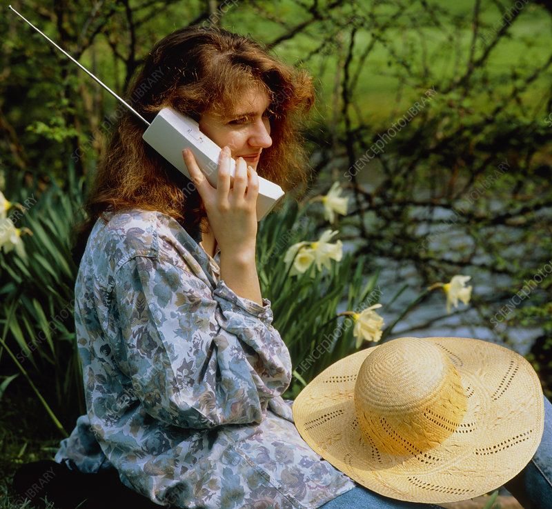 A woman using a cordless telephone.