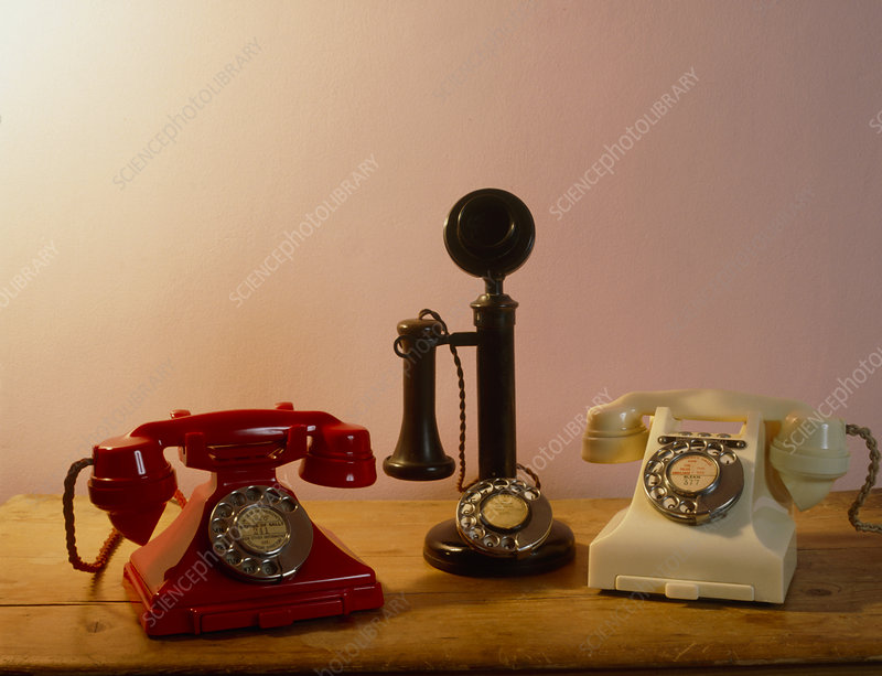 Three old Bakelite telephones