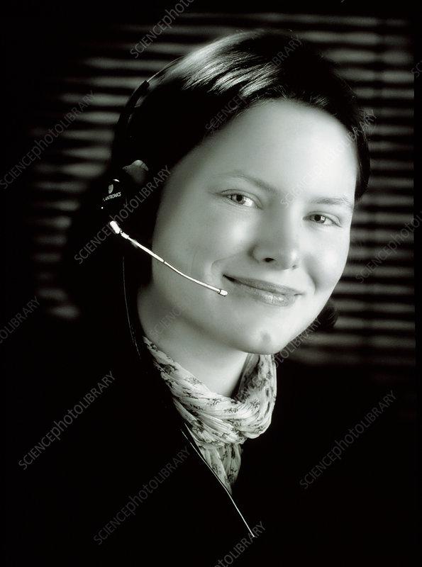 Businesswoman wearing a telephone headset