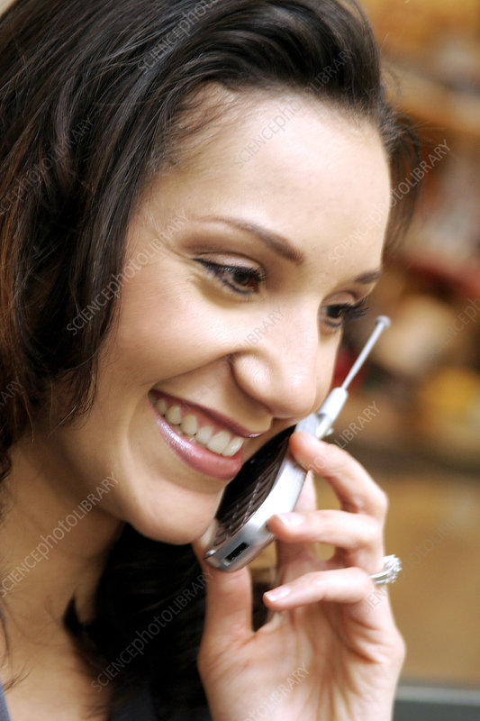 Hispanic Businesswoman on her Cell Phone