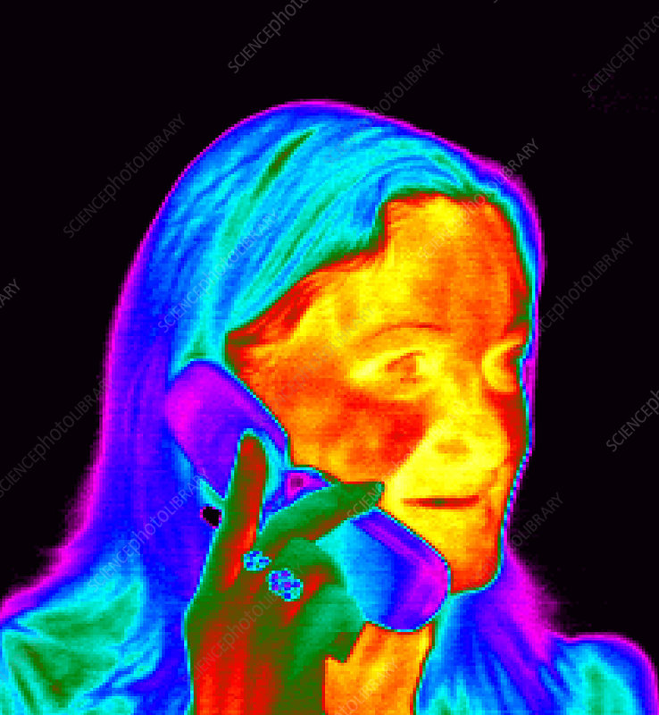 Woman using a mobile phone, thermogram