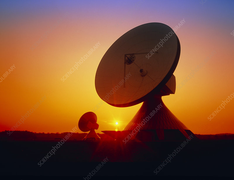 Satellite dishes near Munich, Germany at sunset