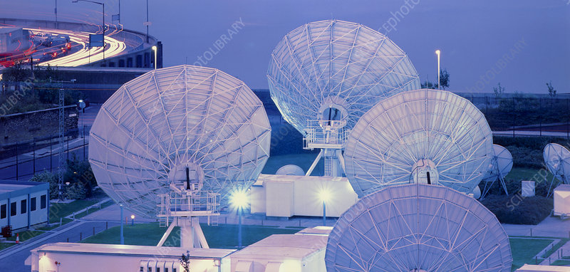 Satellite dishes at nighttime