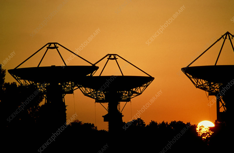 Silhouette of satellite communication dishes