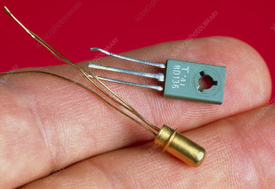 Fingers hold transistors from the 1960s & 1970s