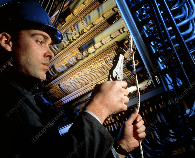 Technician working on ship's circuitry