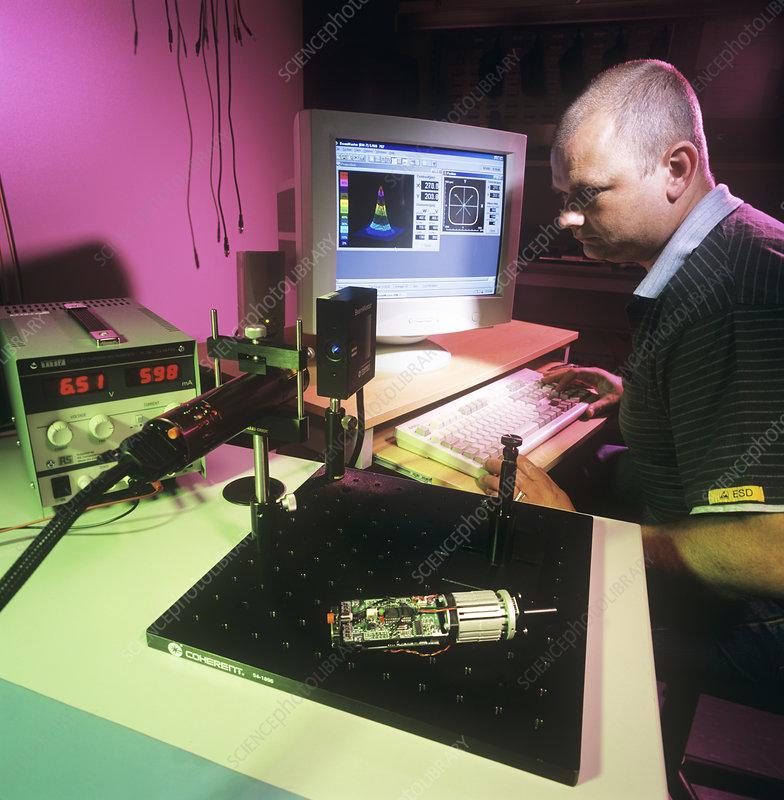 Technician testing a laser diode module
