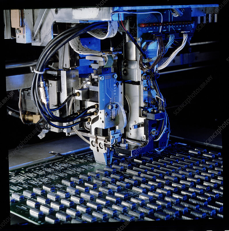 Robot hand assembling an electronic circuit board