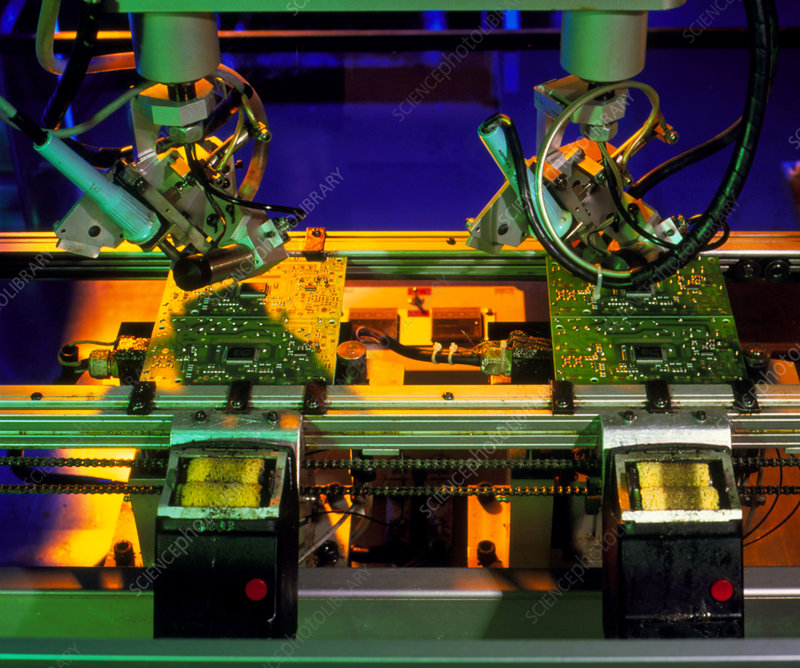 Robot hands soldering components to circuit boards
