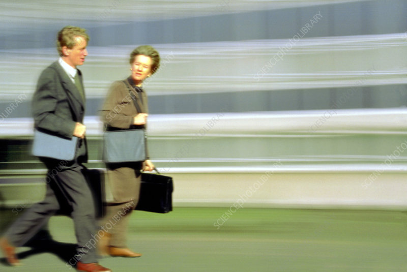 Business man and business woman walking in a hurry