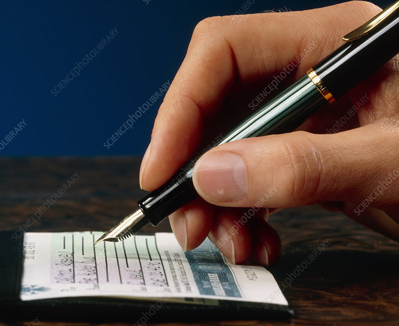 Hand writing a cheque with a fountain pen