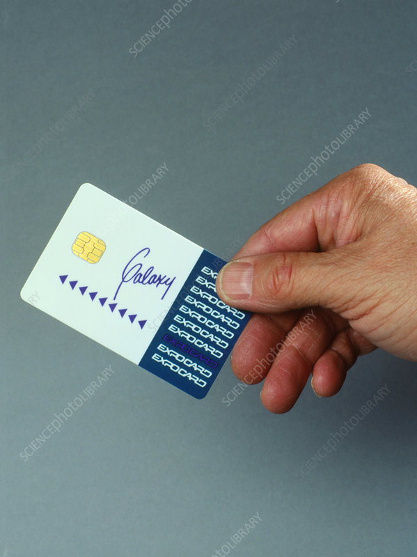 Hand holding a smart card
