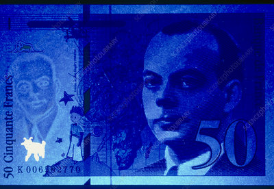 Anti-counterfeit fluorescent markers in a banknote