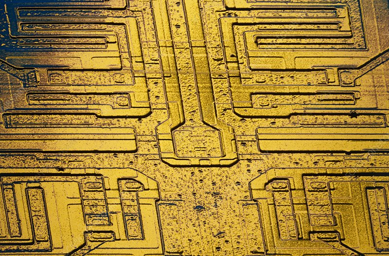 False-col SEM of surface of integrated circuit