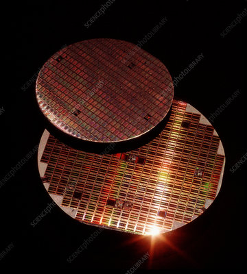 View of two silicon wafers with their chips