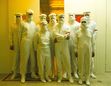Chip-making technicians in clean-room clothing