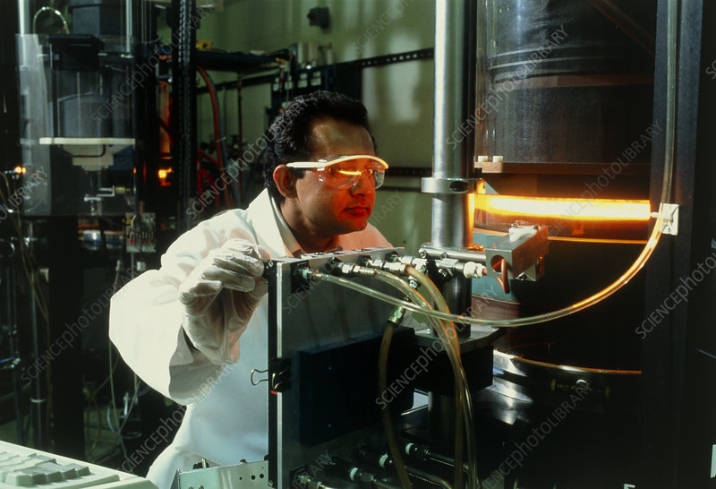 Engineer grows a silicon crystal