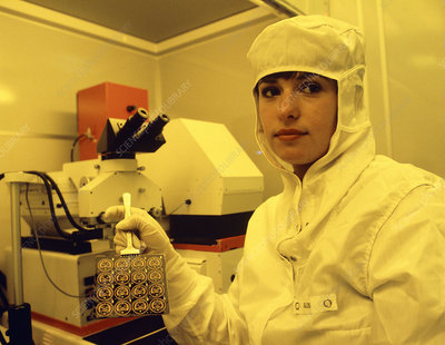 Technician with newly-made integrated circuits