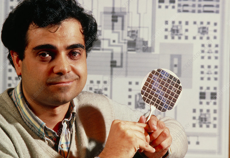 Scientist holding silicon wafer