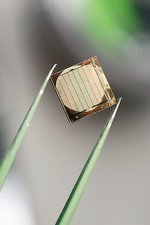 Silicon nanowire device, held by tweezers
