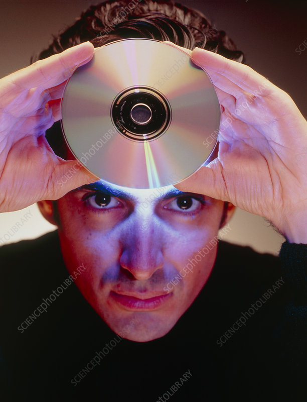 Abstract image of man holding up a CD-ROM disk