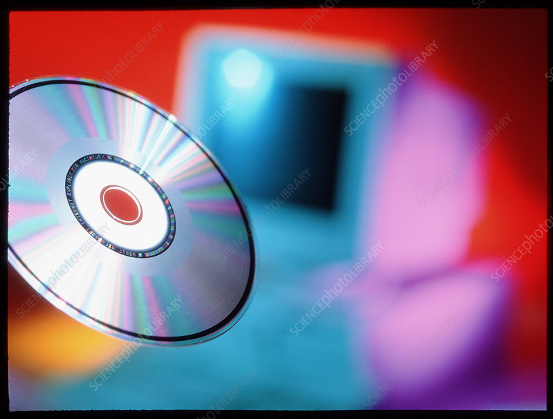 View of CD-ROM disc in front of personal computer