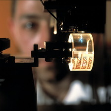 Laser writing optical data onto adhesive tape