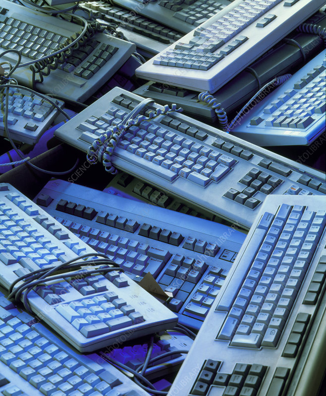 Piles of discarded, redundant computer keyboards