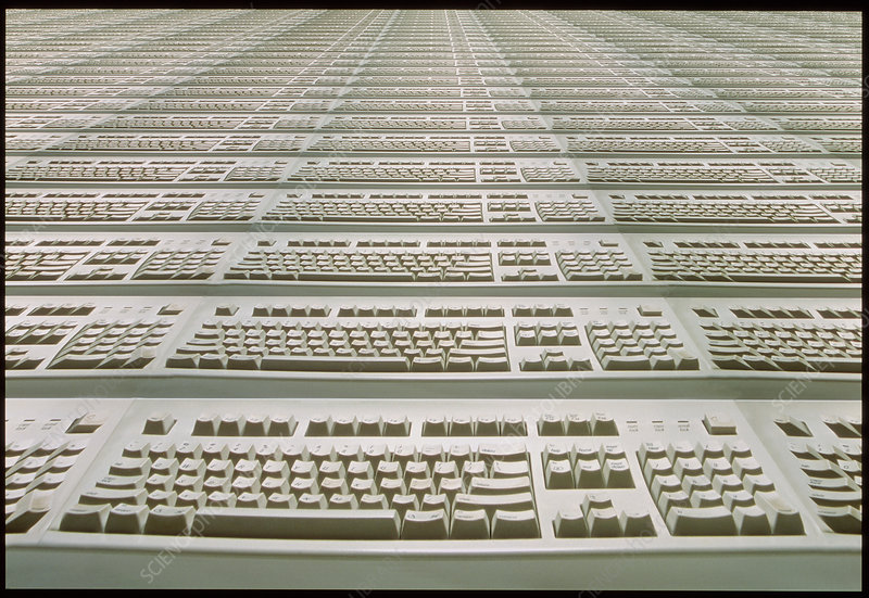 Computer keyboards stretching to the horizon
