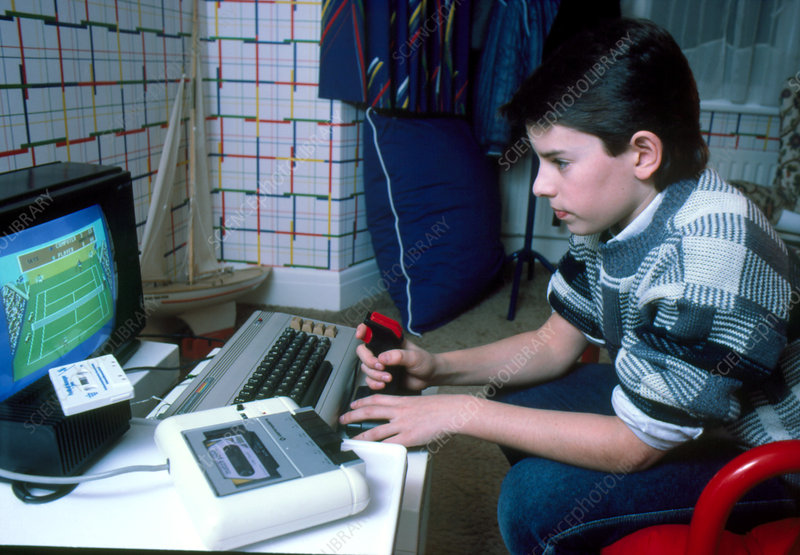 Boy using joystick for personal computer