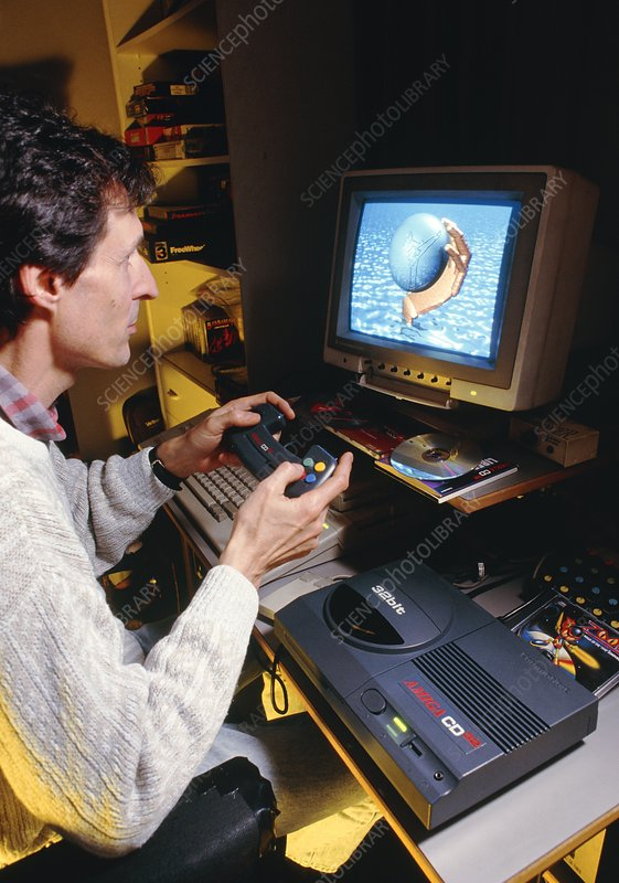 Man playing games on home computer & CD-ROM drive