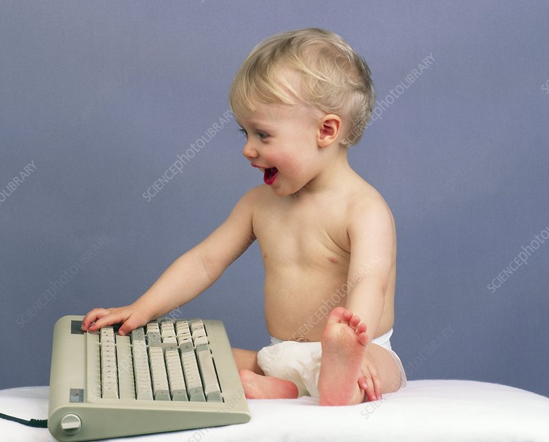 Baby with computer keyboard