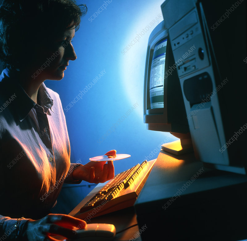 Woman using a personal computer (PC) at home