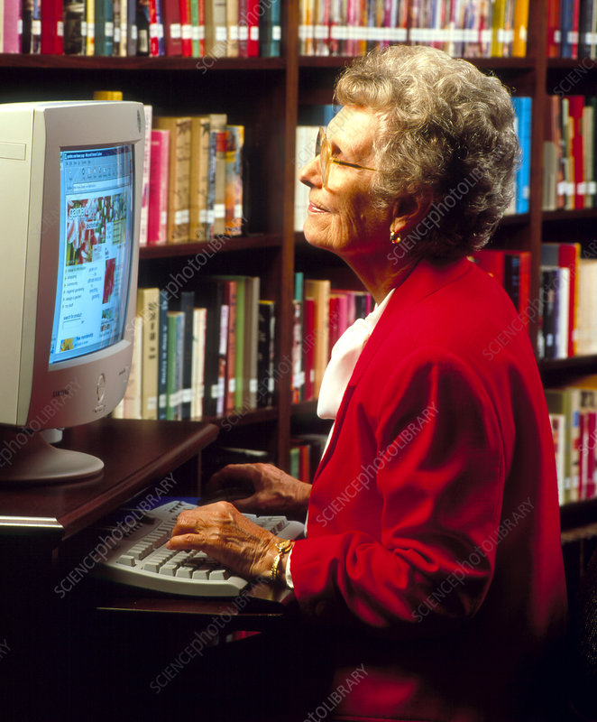 Elderly woman using computer to access the WWW