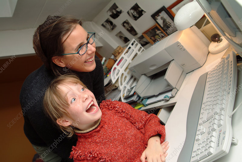 Mother and daughter at a home computer