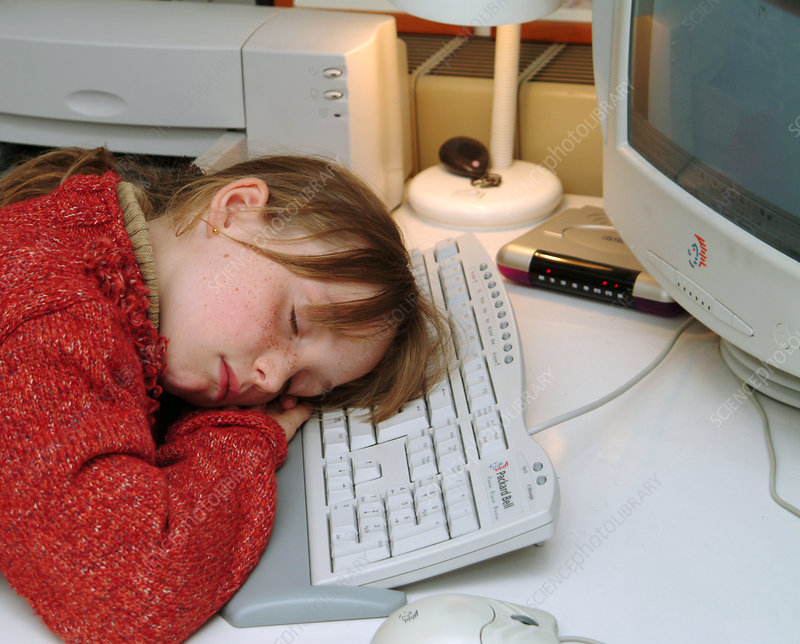 Girl asleep at a home computer