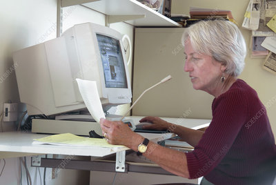 Woman working with a computer