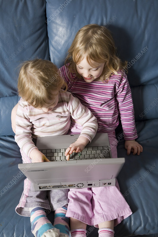 Young girls using a laptop computer