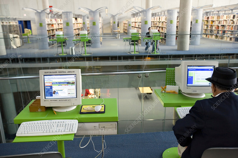Man using a computer in a public library