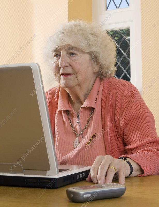 Elderly woman using a laptop computer