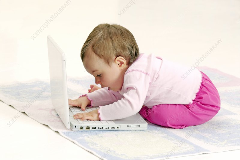 Baby playing with a laptop computer