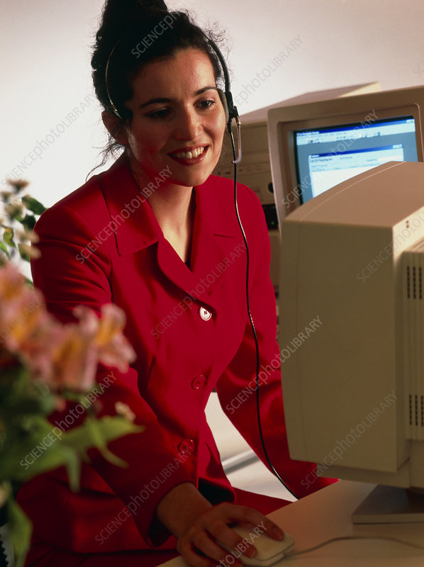 Secretary working at an office computer