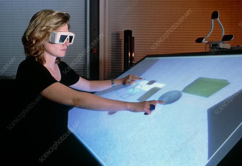 Woman using a 3-D computer-aided design system