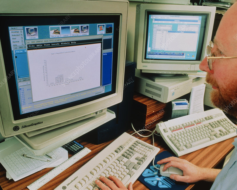 Statistician works on computer graphical data
