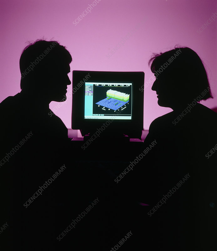 Silhouetted statisticians with a computer 3D graph