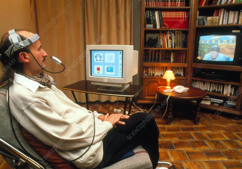 Disabled man uses eye access interactive computer