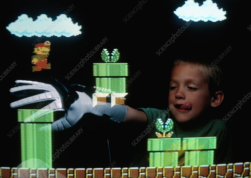 Boy playing video game with Nintendo power glove
