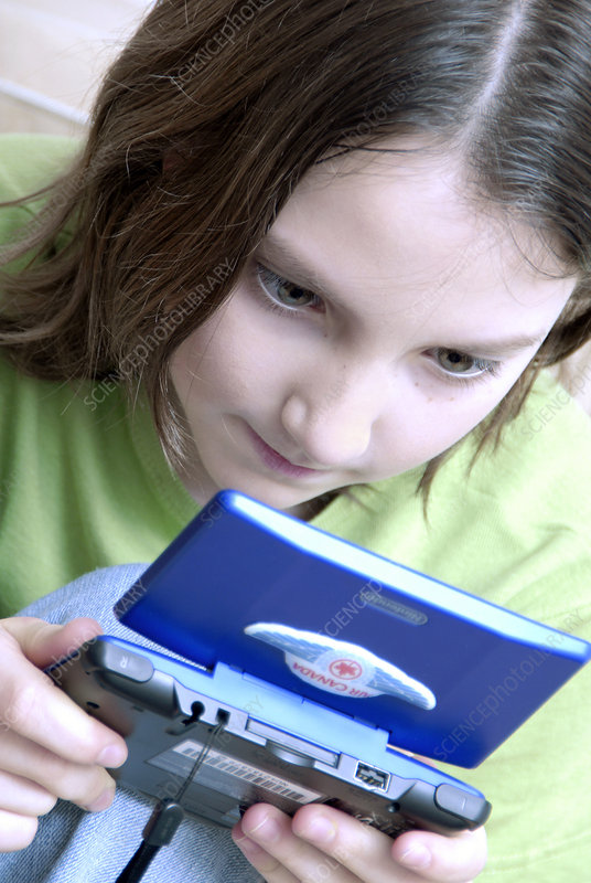 Girl playing on a games console