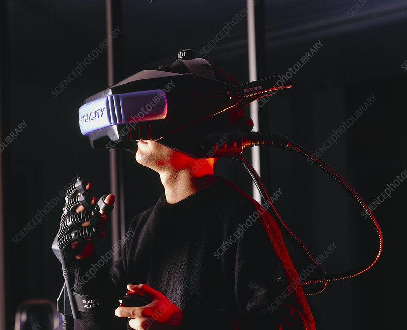 Researcher wearing virtual reality helmet & glove
